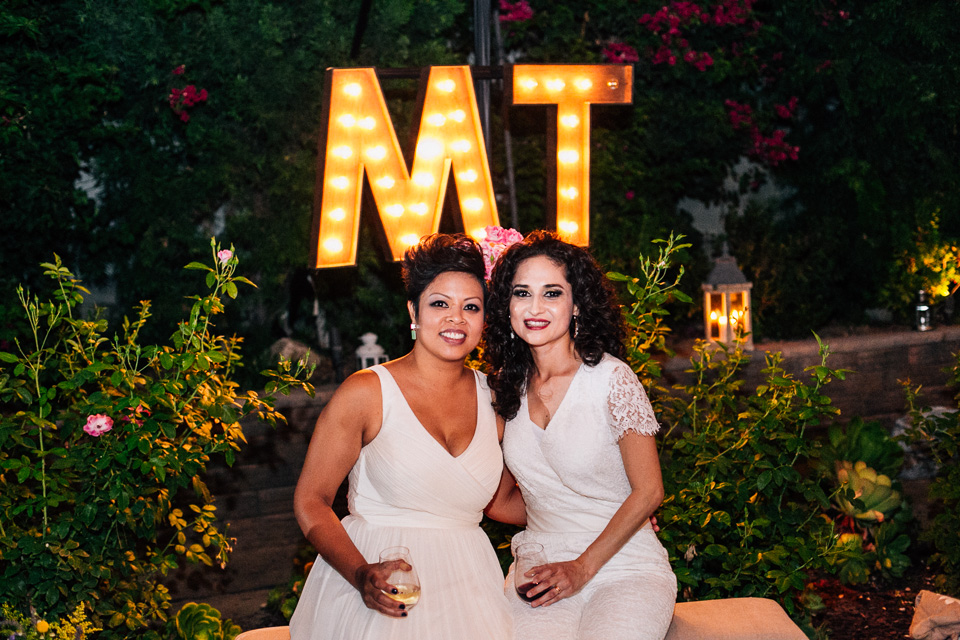 Los Angeles sweet romantic modern lesbian backyard wedding with initial marquis sign