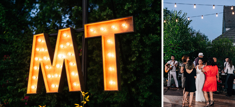 Custom wooden lighted marquee initial sign at lesbian backyard wedding