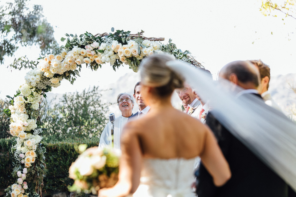 Calabasas wedding ceremony with beautiful rose floral arch