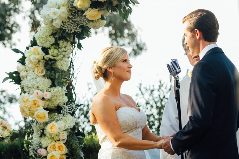 Los Angeles wedding photography. Beautiful floral ceremony archway.