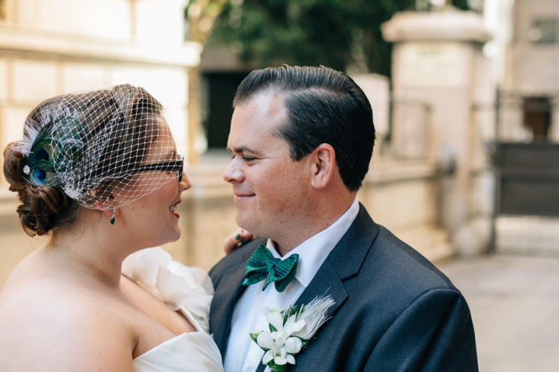 Los Angeles wedding photography. Peacock feather birdcage veil.