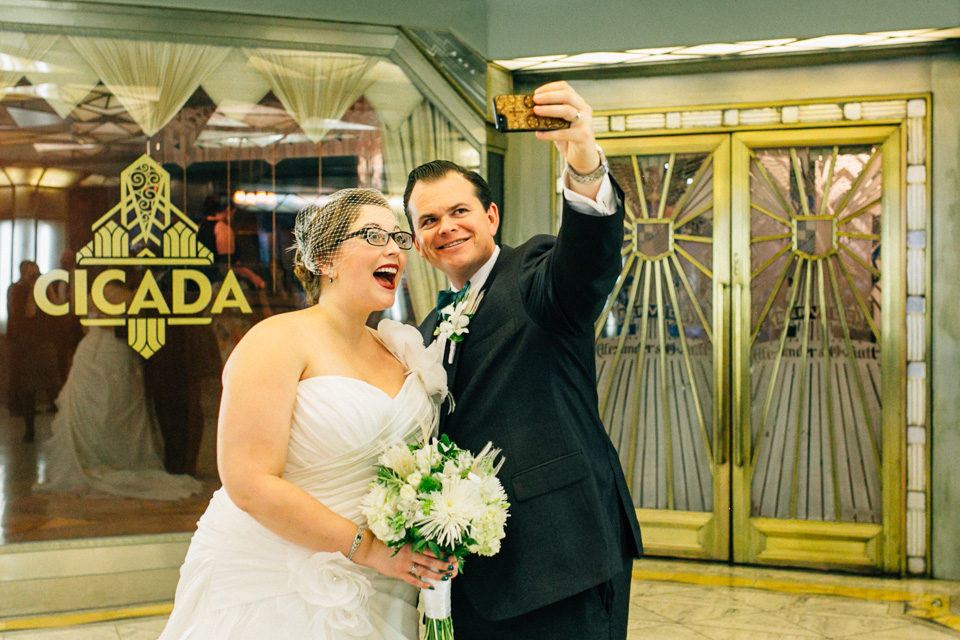 Cicada Club wedding. Bride and Groom take selfie photo.