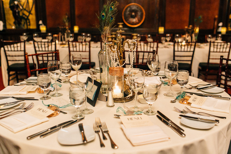 Beautiful non-floral wedding centerpieces with candelabras, vases, peacock feathers, vintage bottles, gold trays