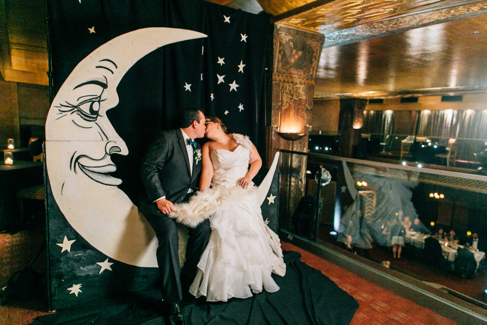 Art Deco wedding complete with vintage paper moon photo booth at Los Angeles wedding