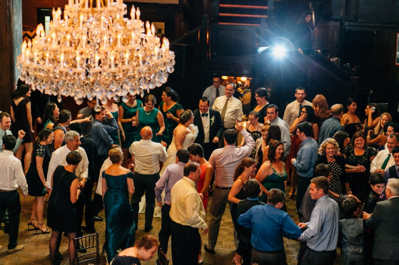 Beautiful chandelier over dance floor at art deco wedding reception