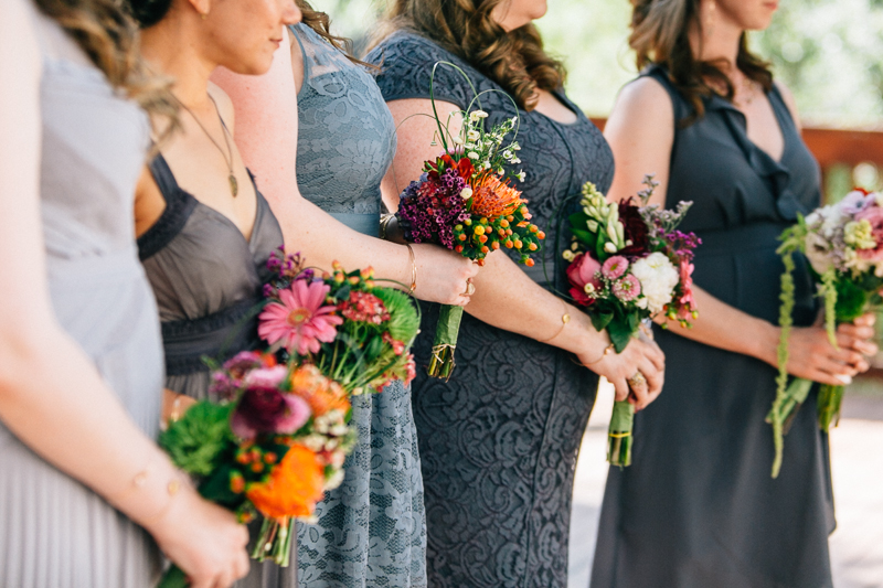 mix and match grey bridesmaids dresses and colorful bouquets