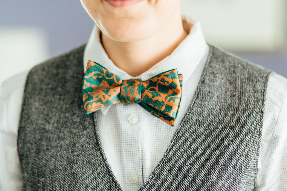 copper and green bow tie at a sweet lesbian wedding in Orange County