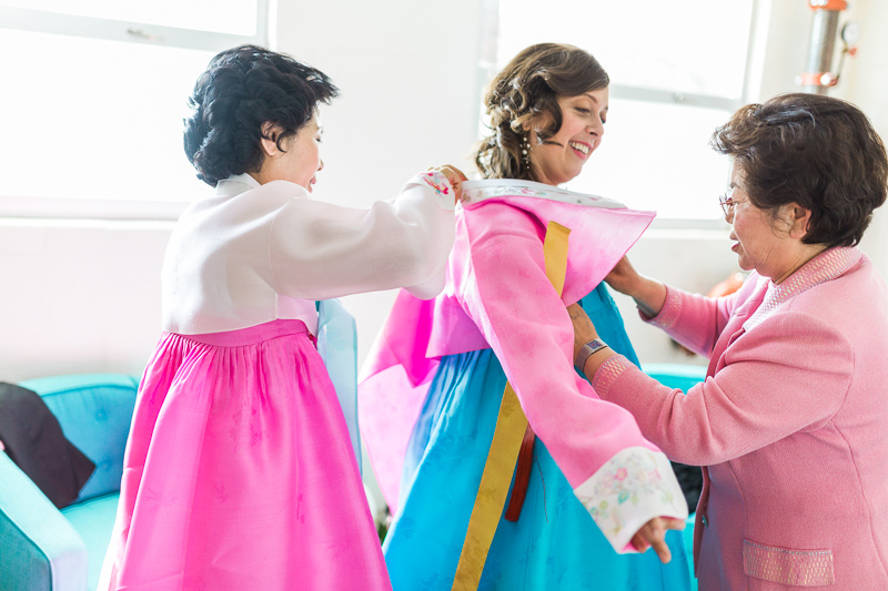 Bride puts on Hanbok for intercultural Korean wedding ceremony