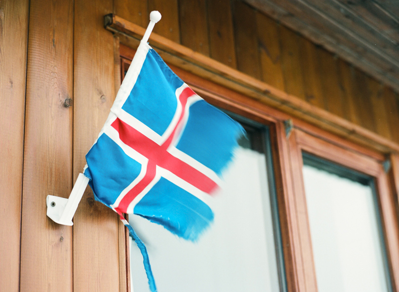 Iceland flag in gusty wind. Selfoss, Iceland. Travel photography on film with Mamiya 645 Pro TL.