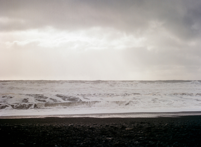 Iceland destination travel photography on film. Reynisfjara black sand beach and ocean.