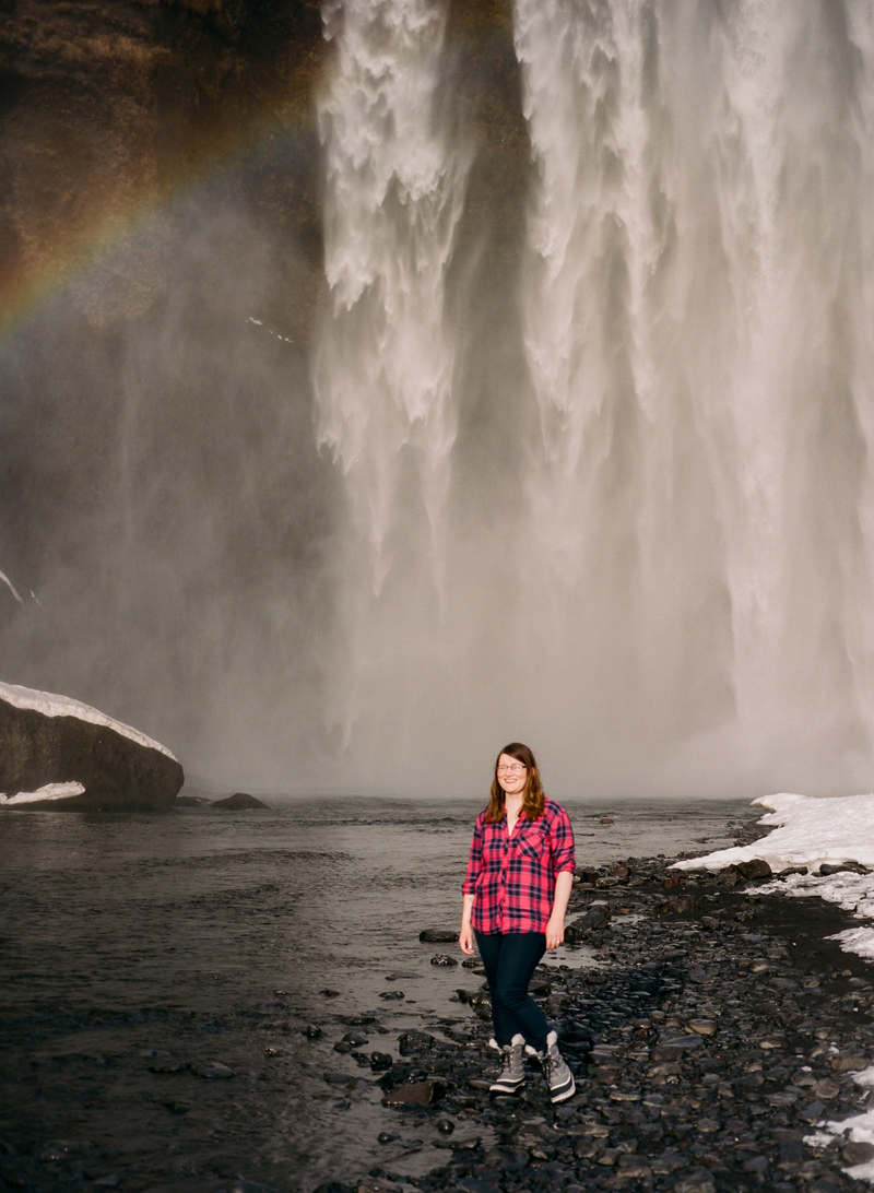 Iceland destination travel photography on film. Portraits with rainbows at Skogafoss waterfall.