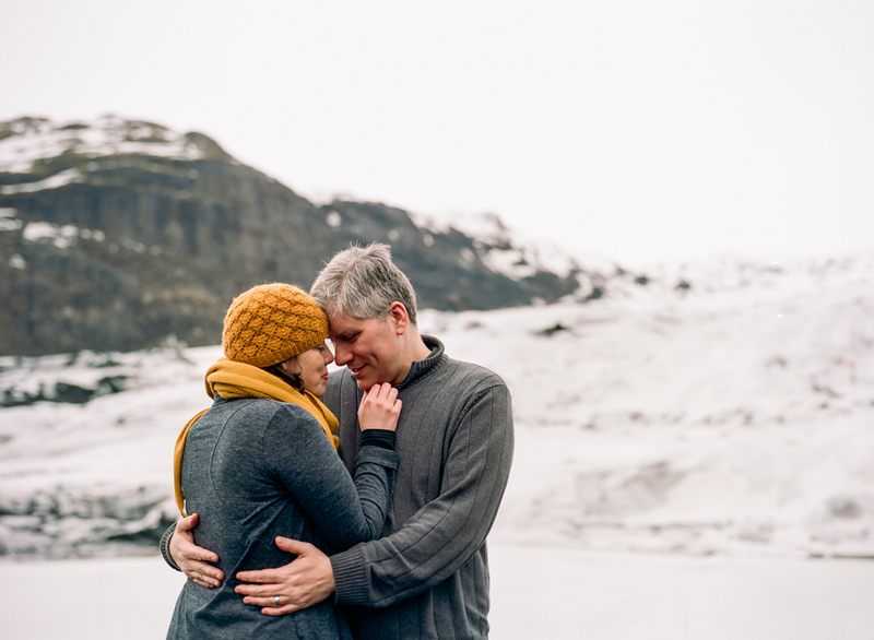 Destination elopement photographer - couple on Solheimjakoll Glacier in Iceland