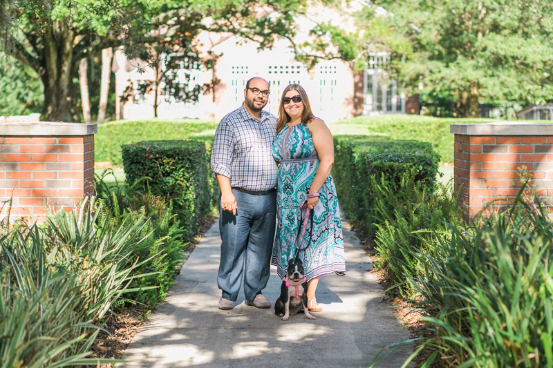 Seminole Heights garden engagement photos with a Boston Terrier puppy