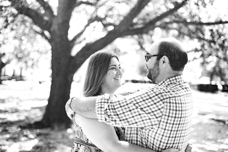 Black and white engagement photos with oak trees and spanish moss