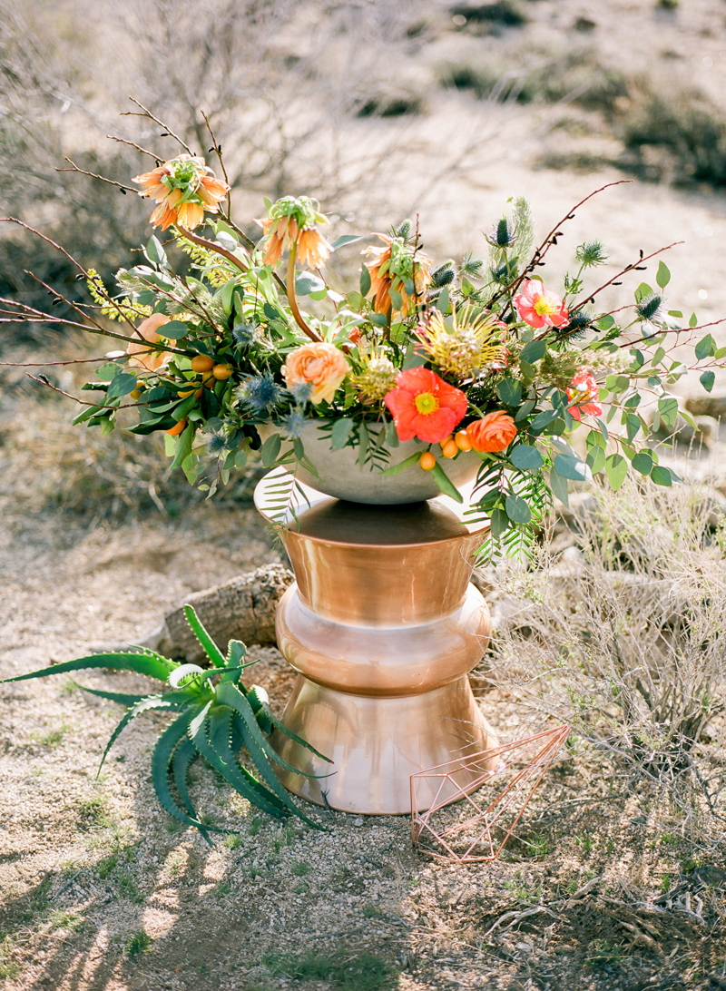 Copper accents, poppies and succulents at a modern desert wedding in Joshua Tree