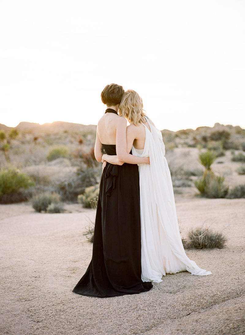 Sunset in Joshua Tree desert with two beautiful brides