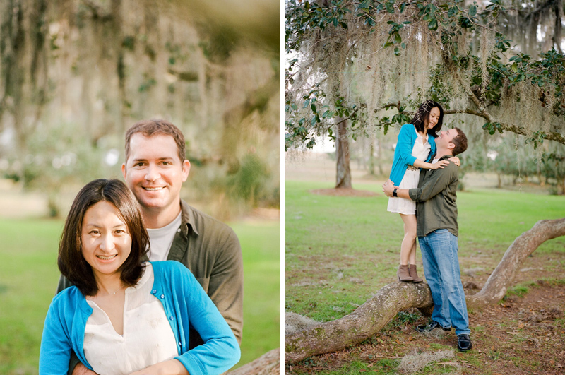 Outdoor engagement photos on film at botanical garden with oak trees and spanish moss