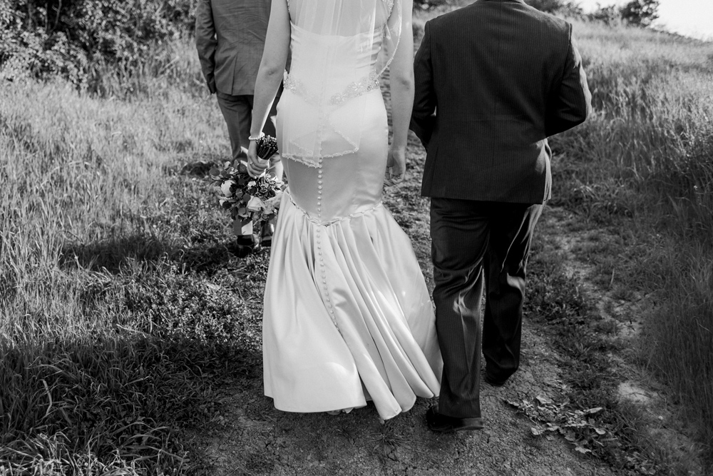 Los Angeles outdoor elopement. Bride and groom hiking on path in Hollywood Hills.