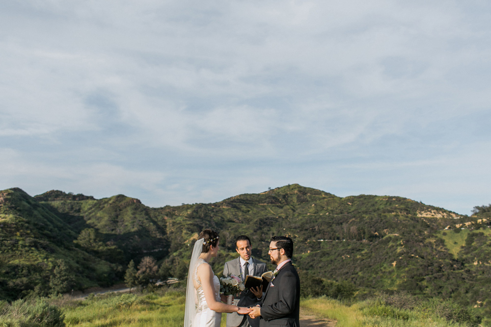 Intimate outdoor wedding at Griffith Park surrounded by nature for sunset ceremony.
