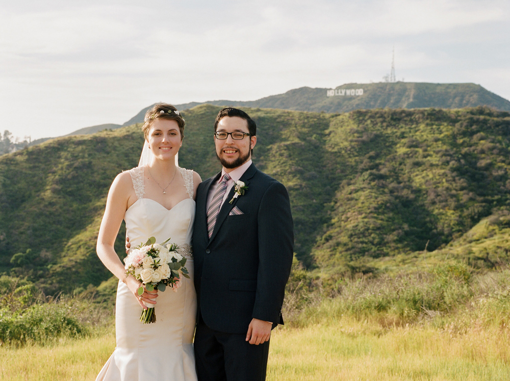 Griffith Park wedding photographer Jessica Schilling. Bride and groom portrait with Hollywood sign.