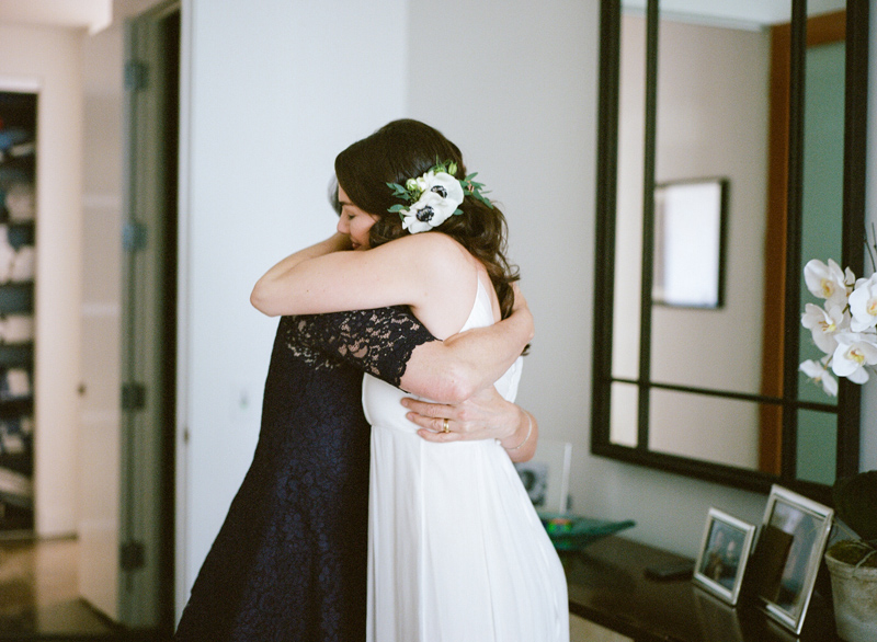 Sweet mother daughter moment at intimate wedding