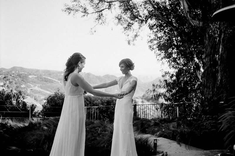 LGBTQ wedding photography. Two brides first look on black and white film.