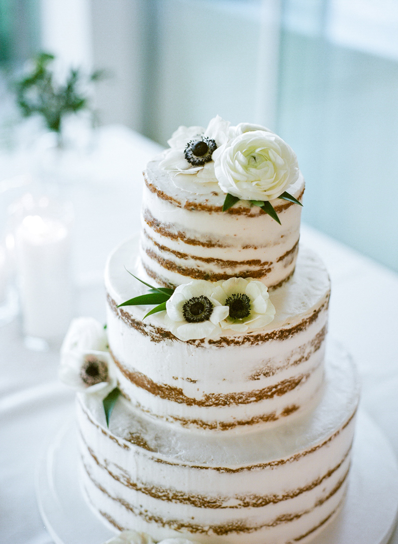 Naked cake with anemone flowers at intimate Bel Air backyard wedding. Kodak Portra 400 film