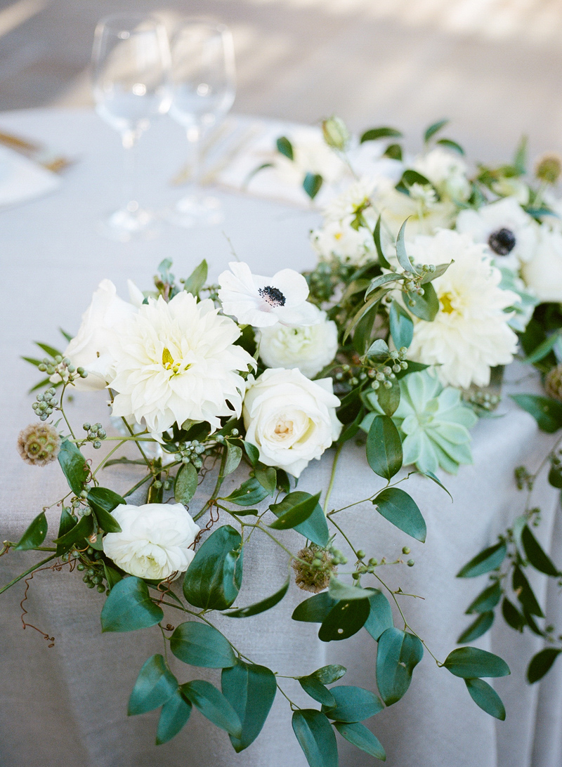 Romantic white and eucalyptus floral arrangements at Bel Air backyard wedding