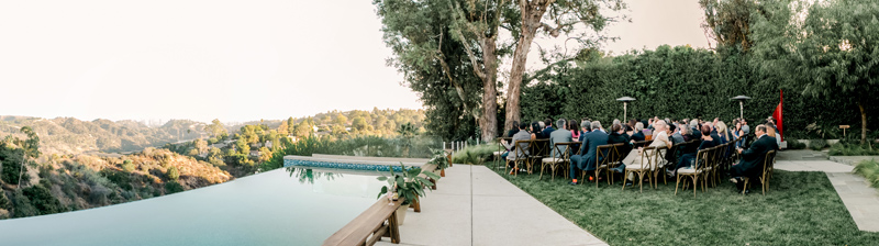 Ceremony views of Hollywood Hills for romantic backyard wedding