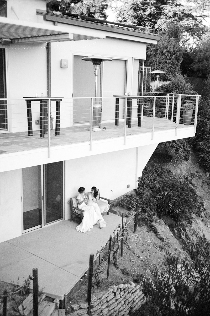 Romantic bridal portraits in Hollywood Hills private residence for two brides wedding