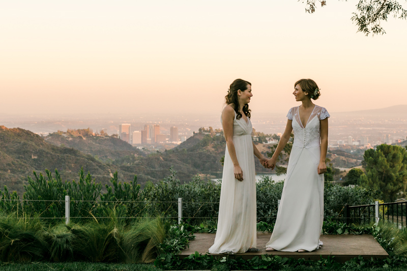 Beautiful sunset views of the Hollywood Hills for romantic outdoor lesbian wedding.