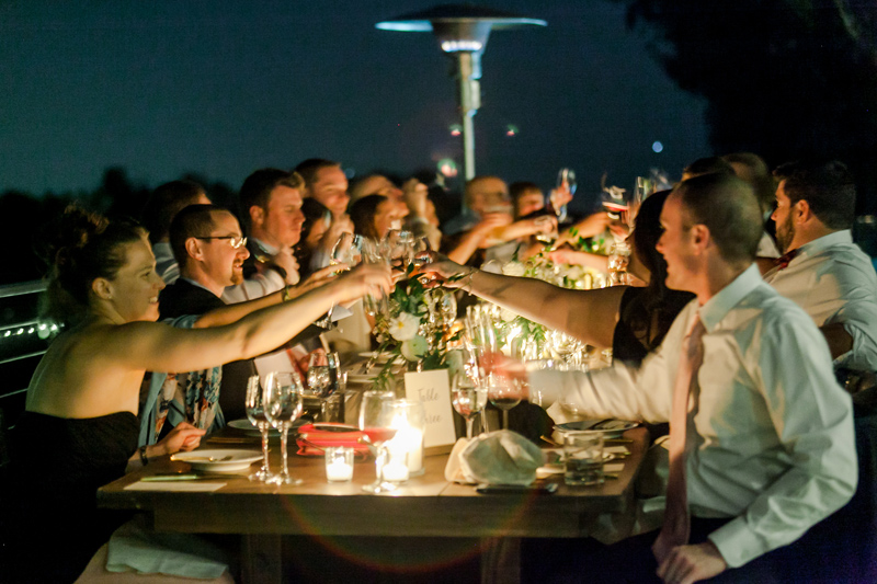 Intimate wedding reception outdoors at night