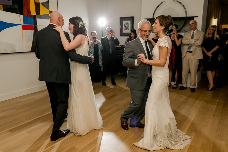 Fathers and daughters dance together at sweet at home wedding