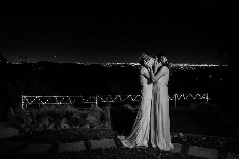 Night time portrait of two brides overlooking the Hollywood Hills