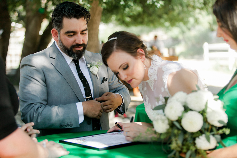 Ketubah signing at modern interfaith Jewish wedding